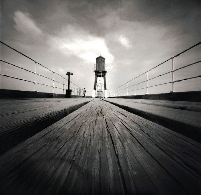 The planks in this image draw our eyes towards the centre. From: http://betterphotography.in/features/camera-problem-pleasing-pinhole-photos/13552/